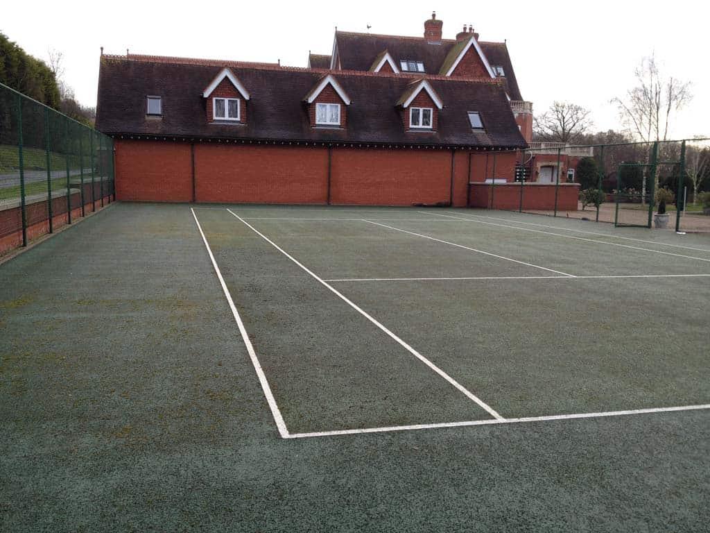 Tennis court restoration before