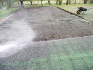 Tennis court repair process, Step 1 cleaning. power wash the court.
