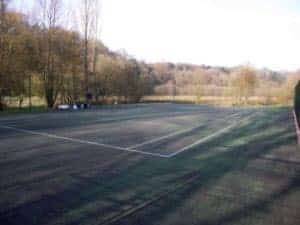 Step 3 of repairing a tennis court, fixing the porous macadam surface