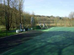 Step 4 of repairing a tennis court, repainting the tennis court and the surround.