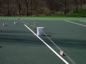Step 7 of the tennis court repair. making sure the lines are exact and dry