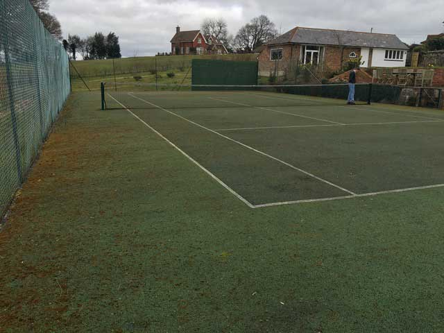 A tennis court in Wadhurst before annual maintenance